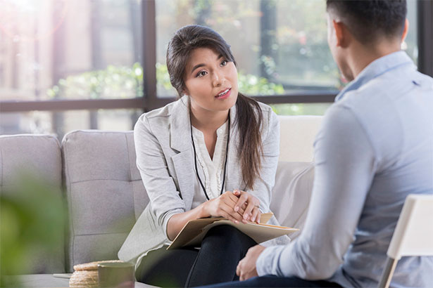 Mental health professional listens intently to patient