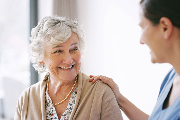 Happy senior woman with caregiver