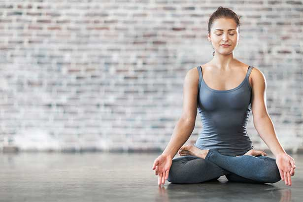Woman doing yoga meditation exercise