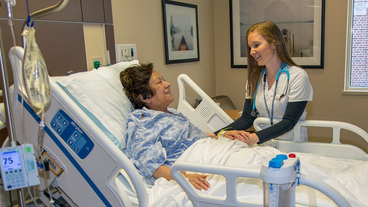 Nurse checking on patient in an orthopedic room